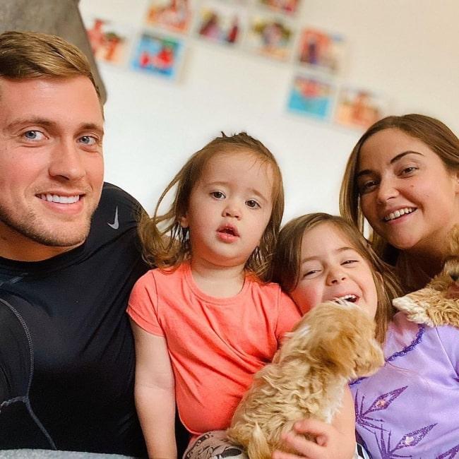 Jacqueline Jossa as seen in a selfie taken with her husband Dan Osborne and their children Ella and Mia Osborne in March 2020