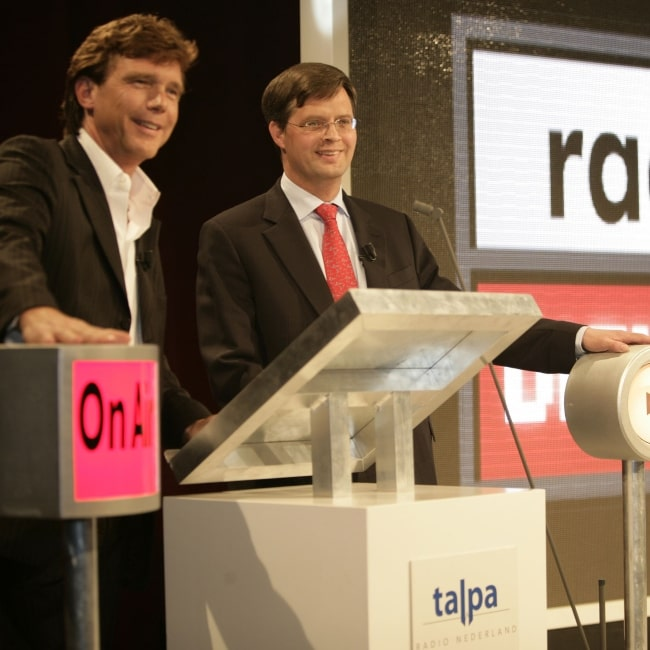 Jan Peter Balkenende and John de Mol Jr. as seen in a picture taken during the opening event of Radio Digitaal on April 26, 2004