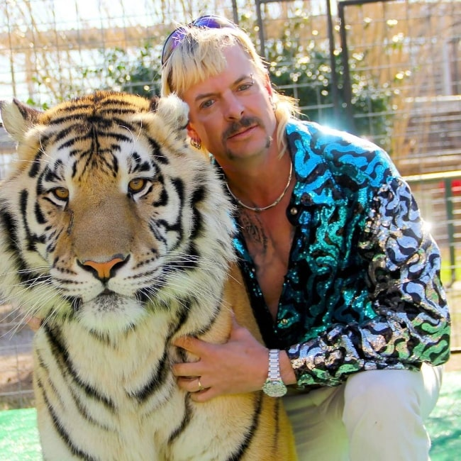 Joe Exotic as seen while posing for a picture alongside a tiger