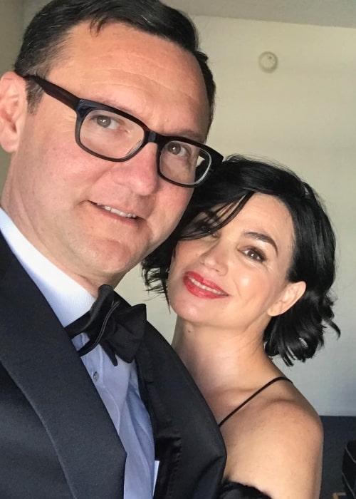 Karen Duffy smiling in a selfie alongside husband John Lambros in June 2018