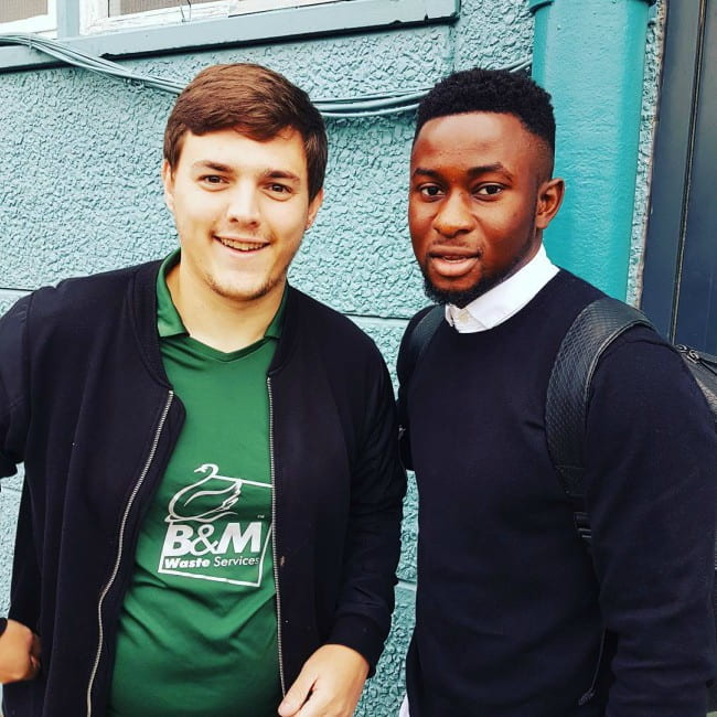 Larnell Cole (Right) with a fan as seen in October 2017