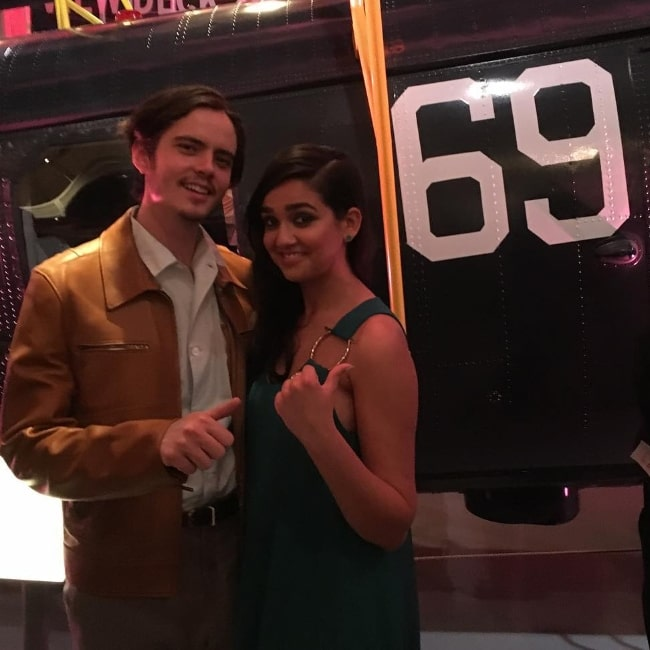 Miles Robbins posing for a picture alongside Geraldine Viswanathan at Intrepid Sea, Air & Space Museum in New York City in August 2018