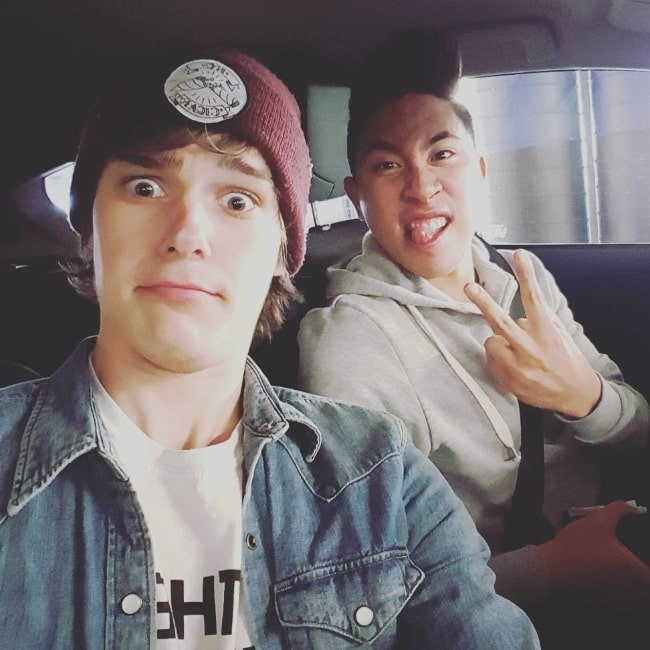 Mitchell Hope taking a car selfie along with Daniel J C Puckey in August 2015