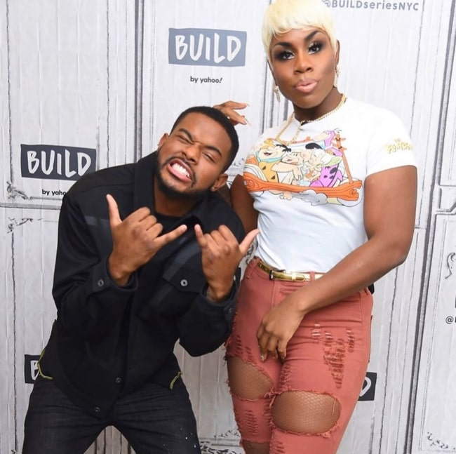 Monét X Change (Right) posing for a picture alongside Trevor Jackson in February 2020