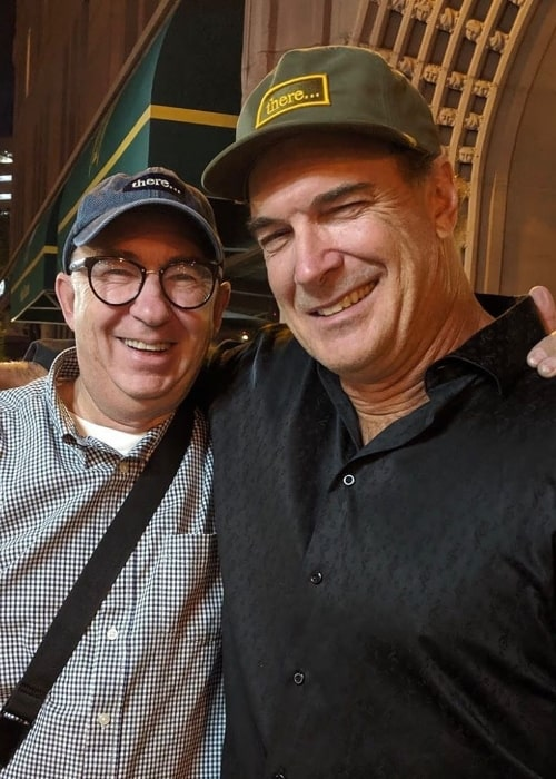 Patrick Warburton (Right) posing for a picture alongside Barry Sonnenfeld in September 2019
