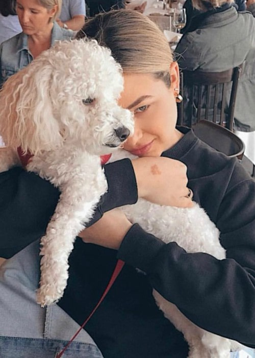Paulina Char with her dog as seen in February 2020