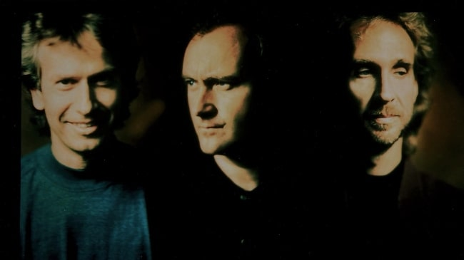 Phil Collins with his two 'Genesis' bandmates, Tony Banks (Left) and Mike Rutherford (Right), in 1991