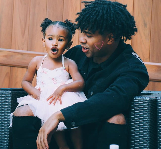 Prettyboyfredo with his daughter as seen in November 2019