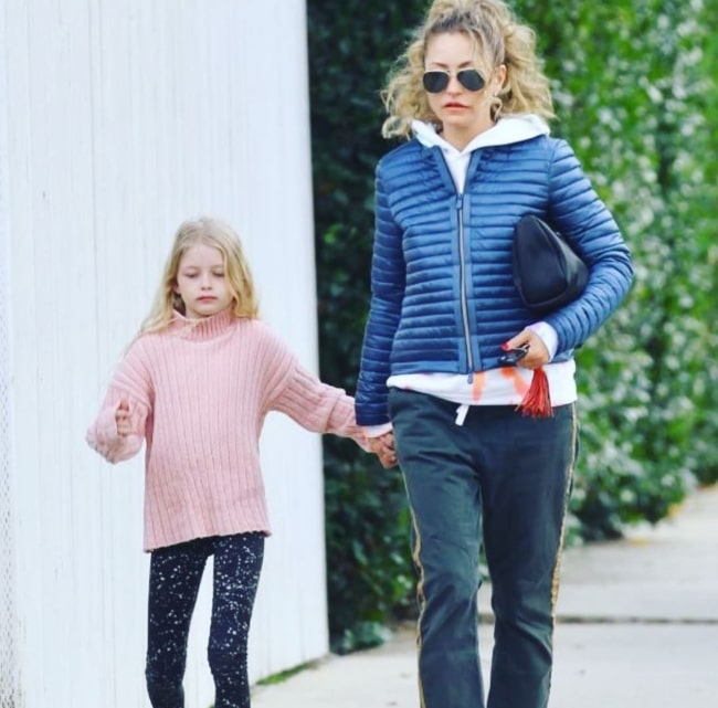 Rebecca Gayheart in January 2020, walking with her 8-year-old daughter who will still hold her hand