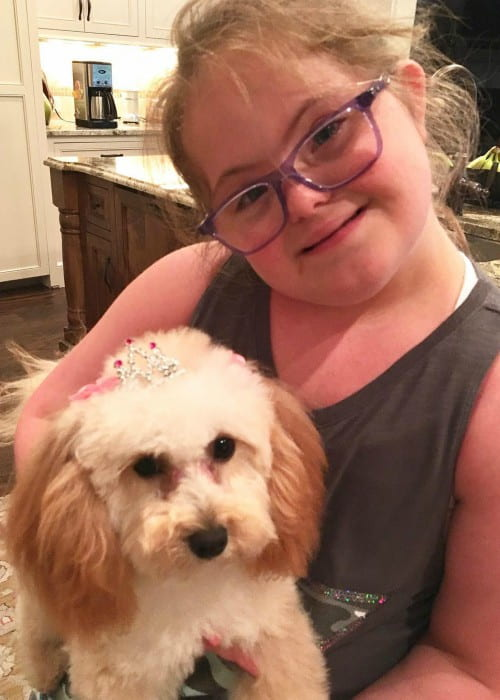 Sarah Grace Morris with her dog as seen in August 2017