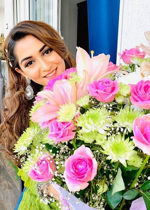 Srishti Jain as seen in a picture taken in January 2020, while holding a large bouquet of flowers