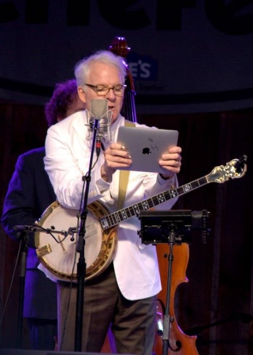 Steve Martin pictured while reading his 'thousand-dollar set list' at MerleFest in 2010