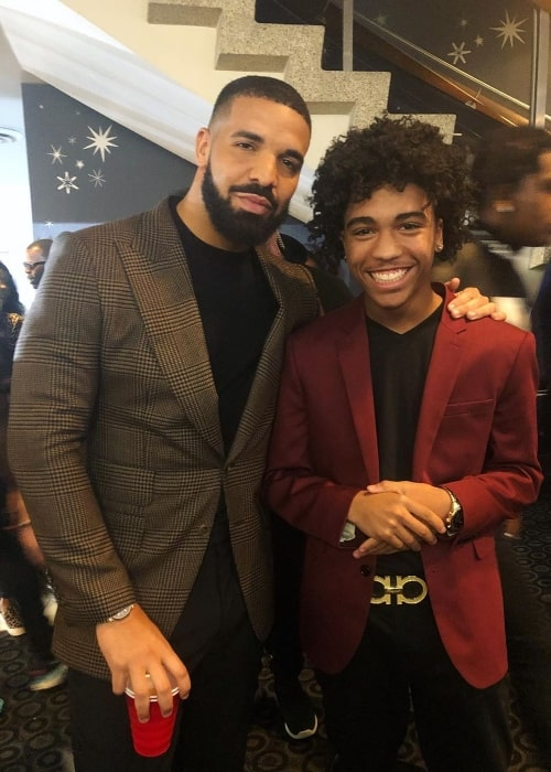 Tristan Timmons (Right) posing for a picture alongside Drake in June 2019