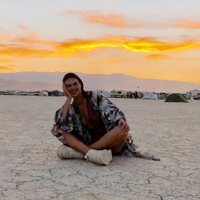 Zita Vass posing for a picture with a scenic backdrop at Black Rock Desert in September 2018
