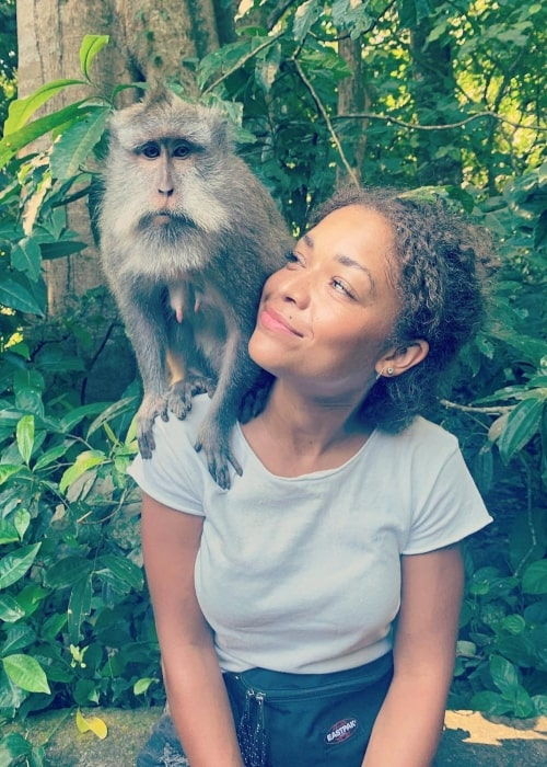 Antonia Thomas in a picture taken with a monkey in April 2019