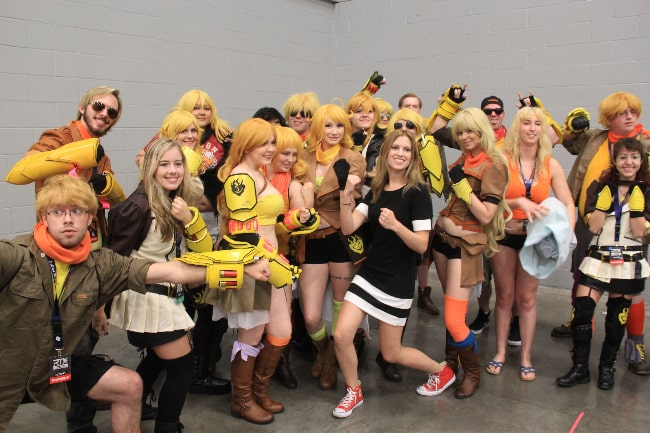 Barbara Dunkelman (Center) as seen while posing for a picture with a group of cosplayers dressed as Yang Xiao Long, her character in 'RWBY', in July 2016