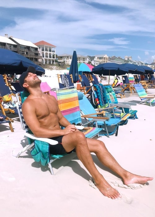 Chris Bukowski as seen in a picture taken while relaxing at the beach in September 2019