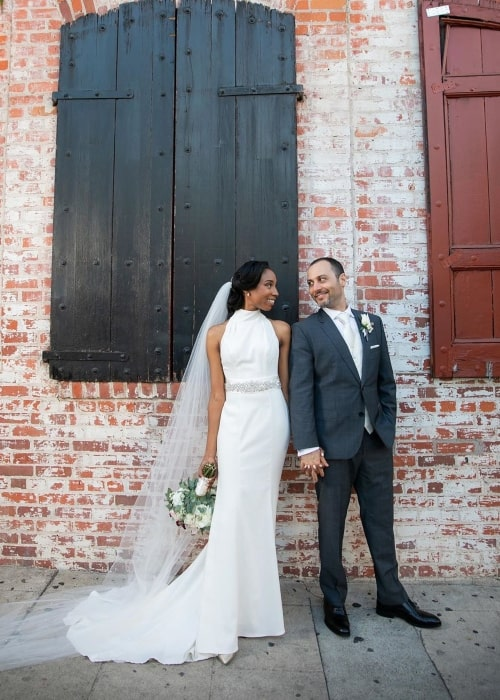 Enisha Brewster as seen in a picture taken with her husband Giuseppe Russo on the day of their wedding on June 23, 2019
