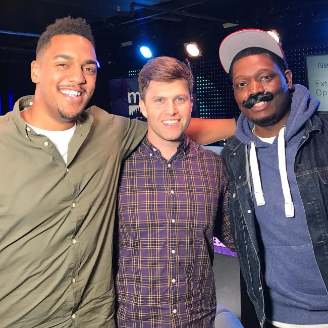 From Left to Right - Rukari Austin, Colin Jost, and Michael Che as seen while posing for a picture in October 2017