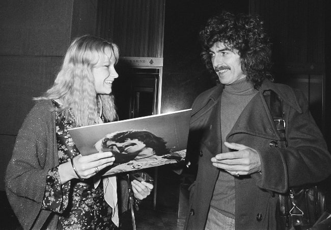 George Harrison as seen while leaving the Hilton Hotel in Amsterdam and signing an album for a fan in February 1977