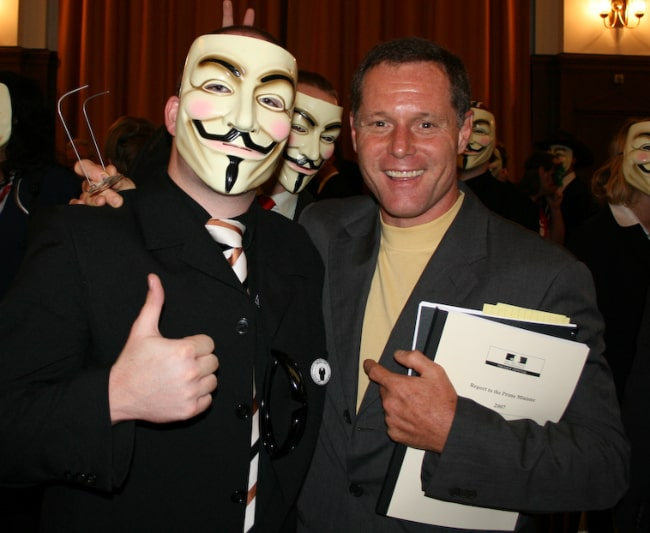 Jason Beghe (Right) posing for a picture with Anonymous at Hamburg conference on Scientology in September 2008