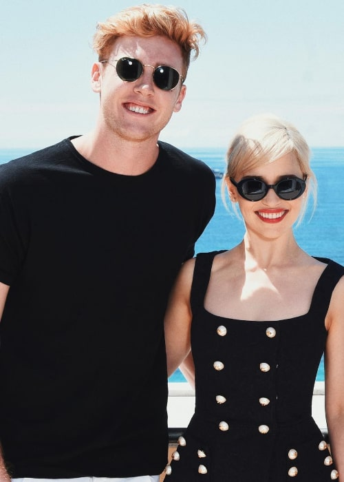 Josh Pieters posing for the camera along with Emilia Clarke in Cannes, France in May 2018