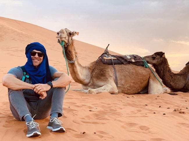 Kyle Howard posing for the camera in Sahara Desert, Morocco in June 2019