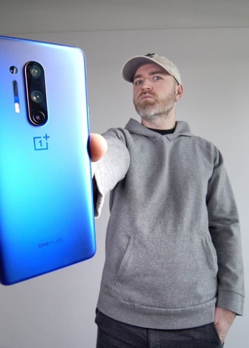 Lewis Hilsenteger as seen in a picture with a OnePlus in a picture taken in April 2020