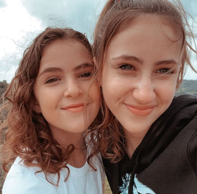 Lexy Kolker (Left) and Ava Kolker as seen while smiling in a selfie in May 2020