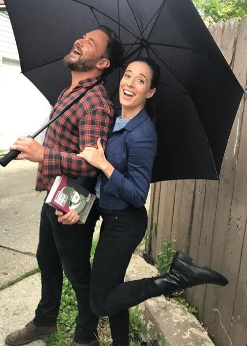 Marina Squerciati having fun with her co star Patrick Flueger under an umbrella in August 2019