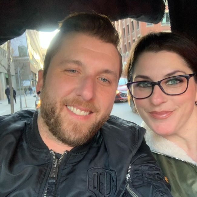 Neil Sanderson seen with his wife Janin in 2020