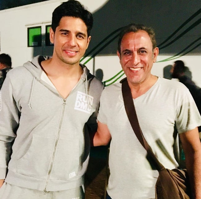 Pawan Chopra (Right) as seen while posing for a picture alongside Sidharth Malhotra in October 2019