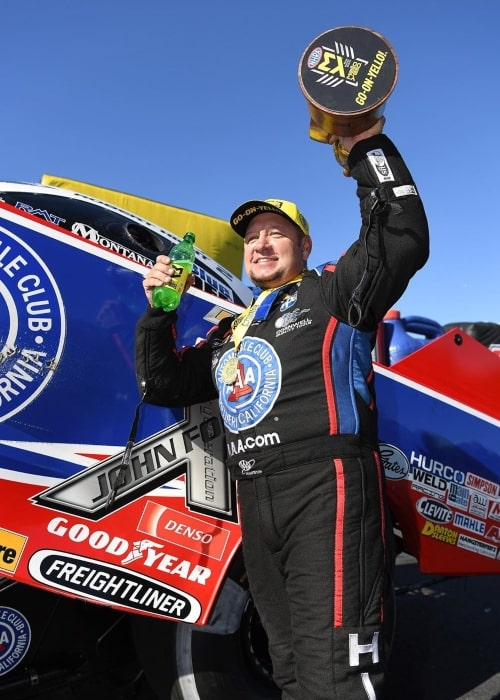 Robert Hight celebrating his 6th season win and 500th round win at the Zmax Dragway in October 2019