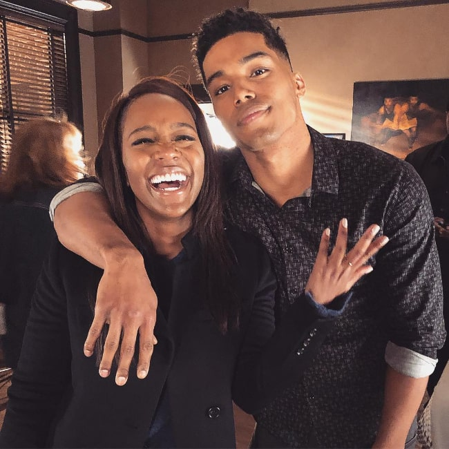 Rome Flynn as seen while posing for a picture alongside Aja Naomi King in February 2019