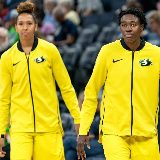 Seattle Storm players Natasha Howard (foreground) and Alysha Clark warming up in July 2019
