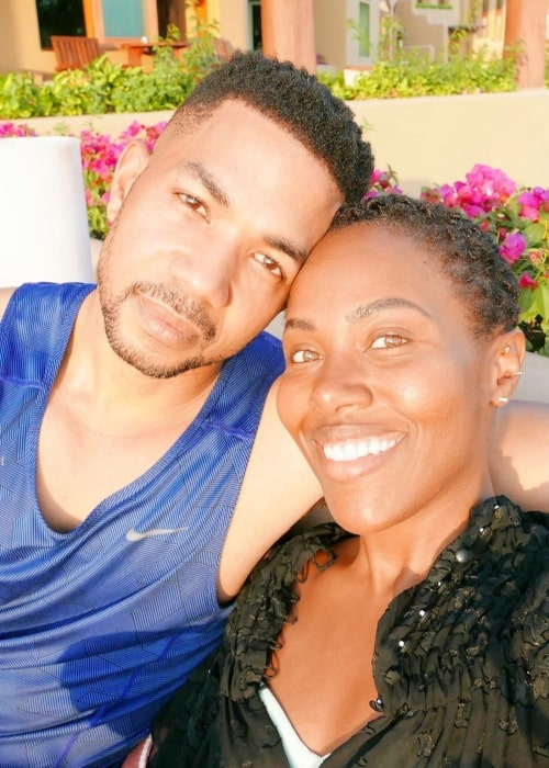 Alano Miller as seen in a selfie taken with his wife actress DeWanda Wise while on a vacation in December 2019