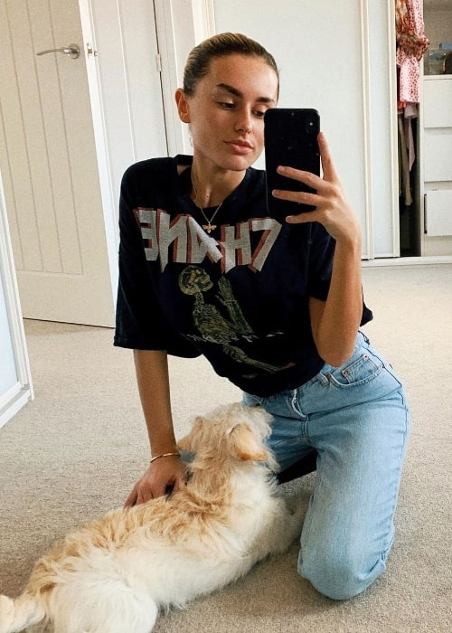 Amber Davies as seen while clicking a mirror selfie along with her pup in April 2020