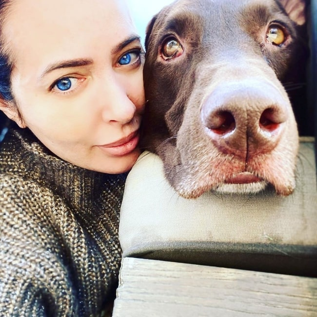 Amy Weber as seen in a selfie taken with her dog in April 2020