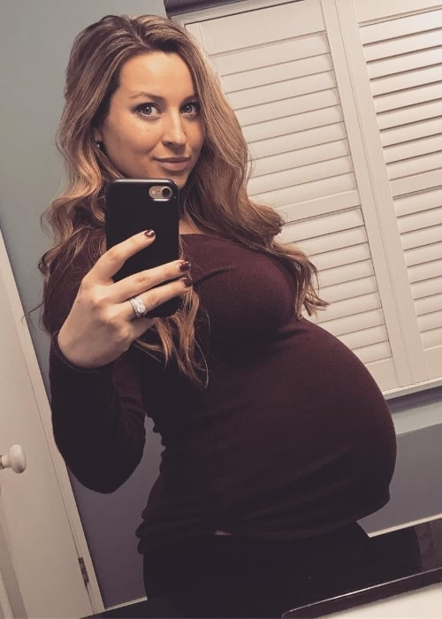 Ashley Leggat as seen while taking a mirror selfie showing her baby bump in May 2019