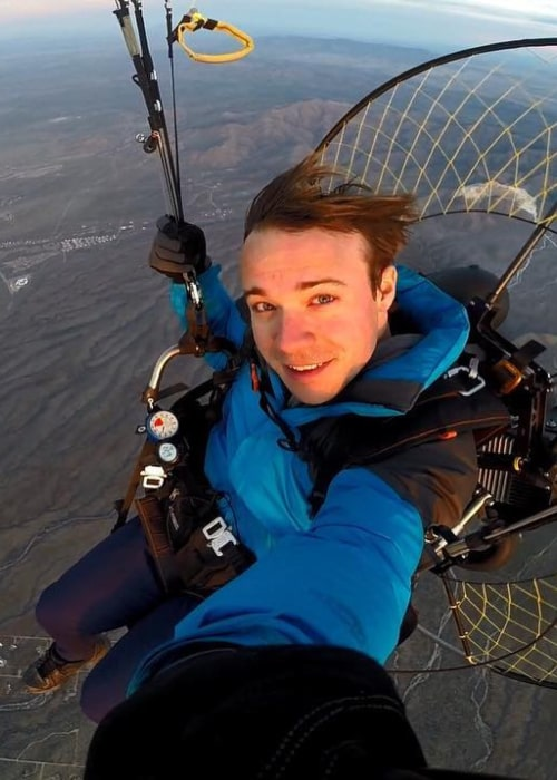 Black Gryph0n in an Instagram selfie that was taken while paragliding in March 2019