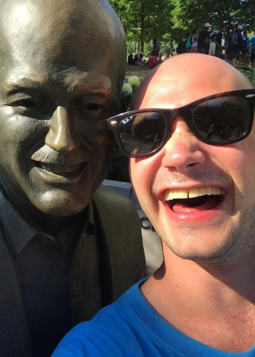 Bryce Hodgson as seen in a selfie taken besides a statue in July 2018