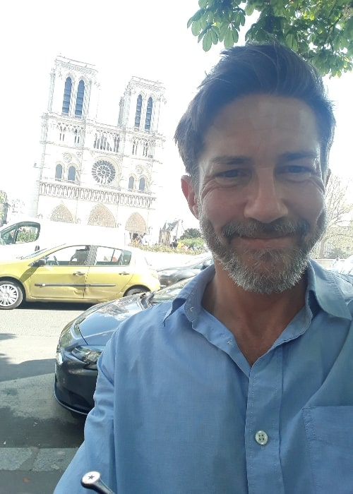 Christien Anholt as seen while smiling for a selfie in Paris, France in April 2018