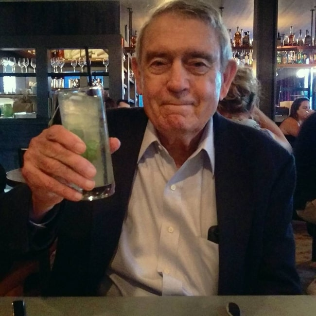 Dan Rather enjoying a drink before an interview in June 2017