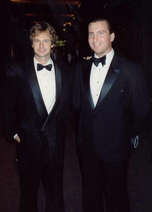 Dana Carvey seen with Mike Clark at the Governor's Ball after the Emmy Awards in 1989