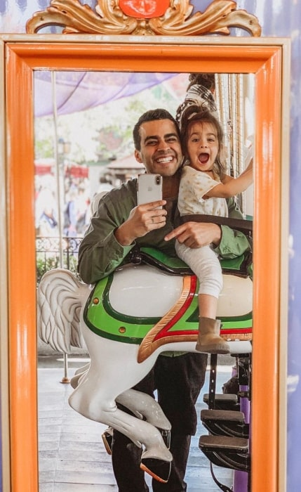 David Lopez having a funtime with his daughter in Disneyland in the past