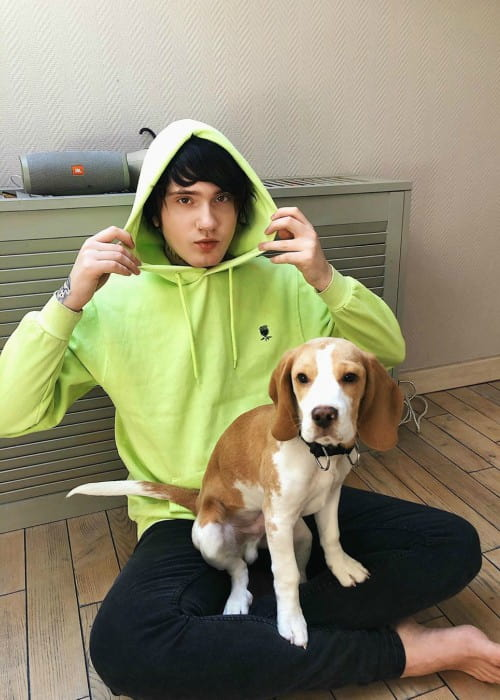 Denis Stoff with his dog as seen in March 2020