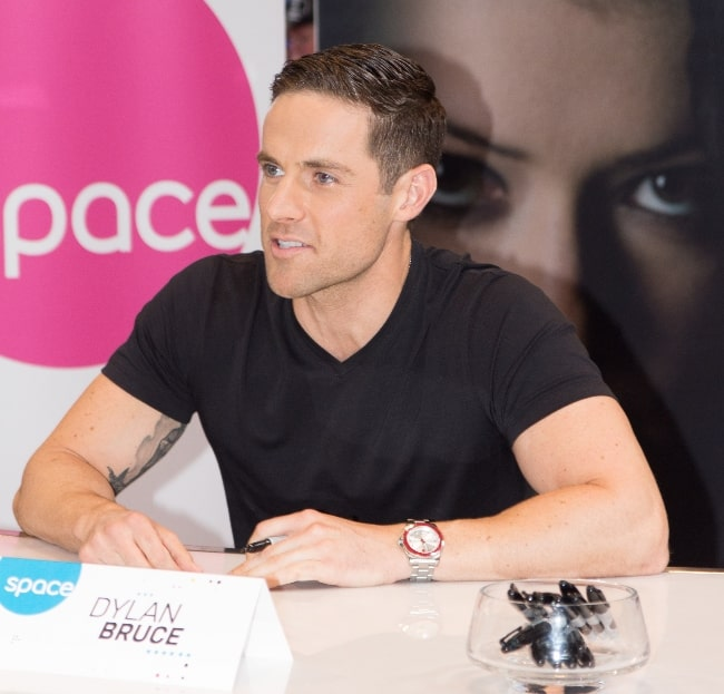 Dylan Bruce as seen during an event in 2013