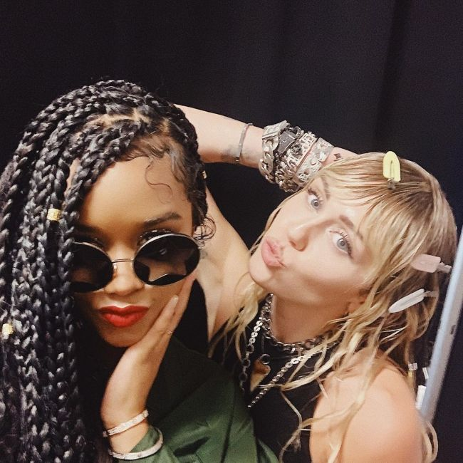 H.E.R. as seen with Miley Cyrus in 2019