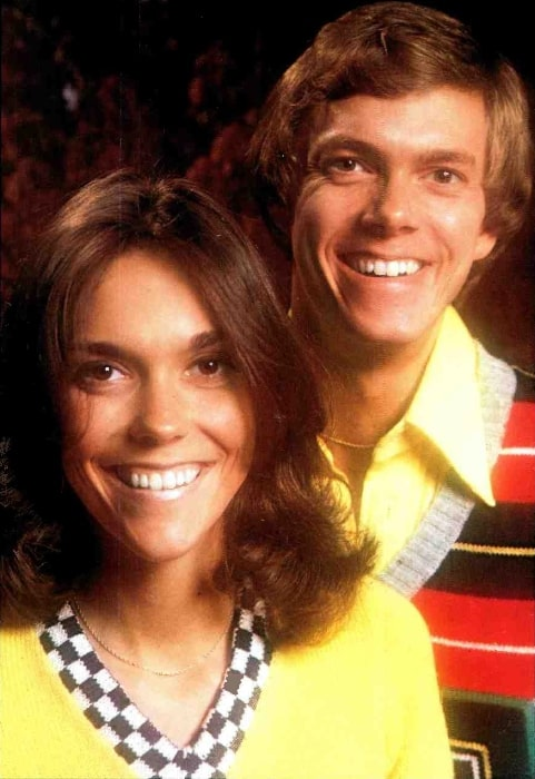 Karen Carpenter and Richard Carpenter as seen while smiling for a picture circa 1974