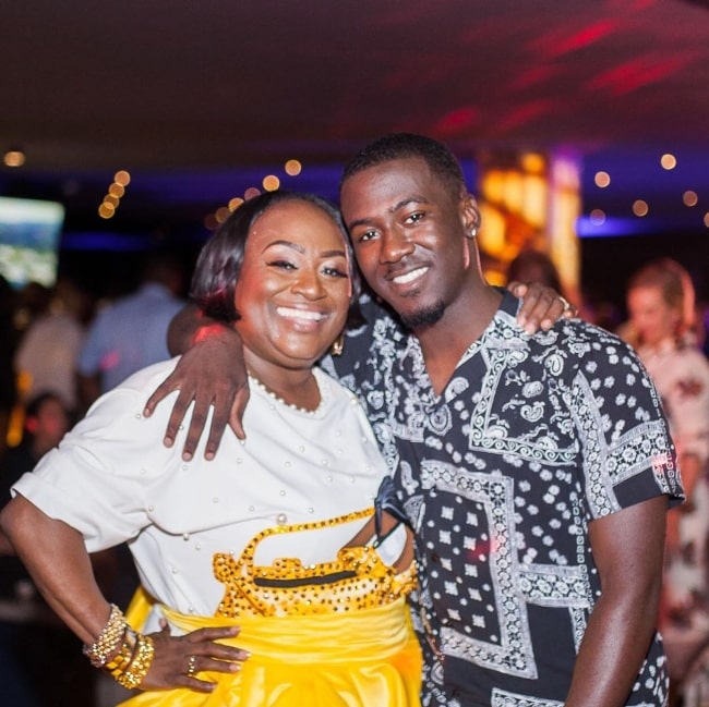 Kwesi Boakye as seen while smiling for a picture alongside his mother